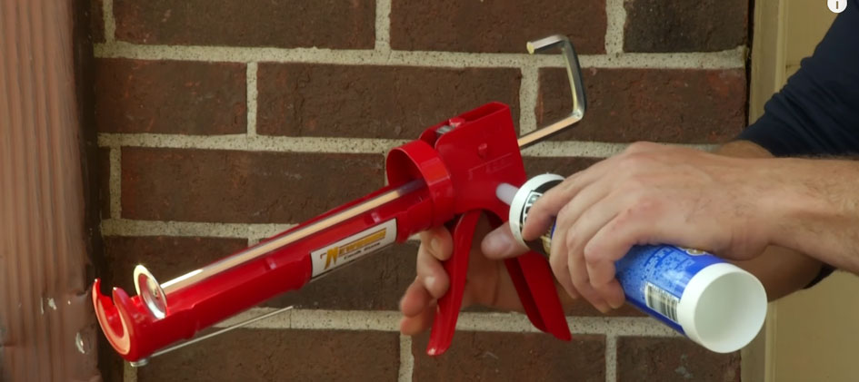 If you have a caulk gun with a tube cutter, squeeze the trigger to cut off the tip